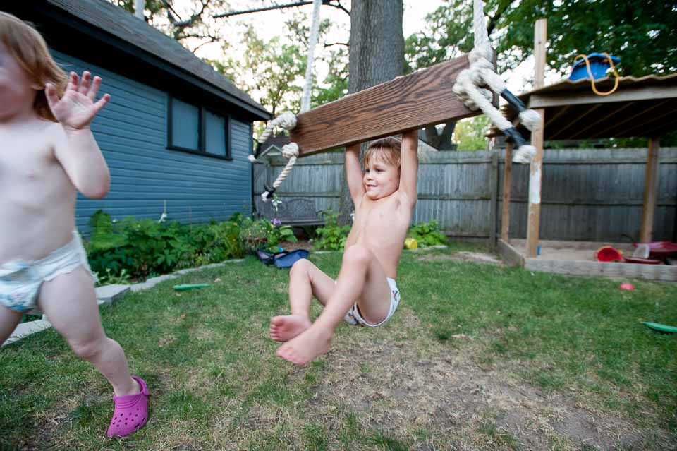 boy-swings-toward-fleeing-girl