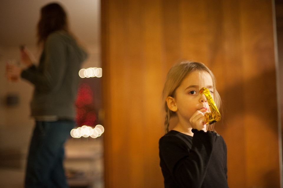 child-with-new-years-eve-noisemaker