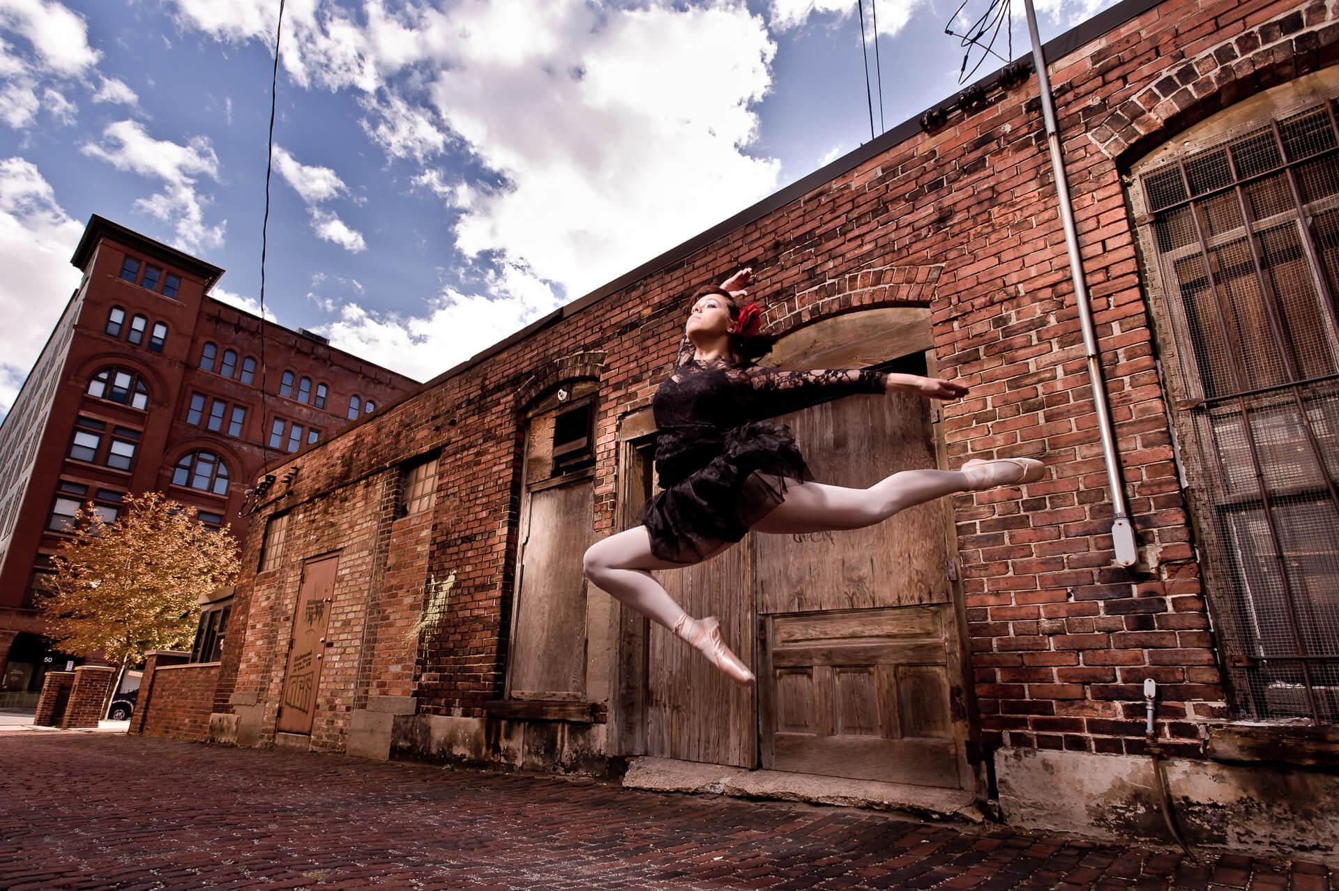 High school ballerina leaps in downtown Grand Rapids senior portrait photography