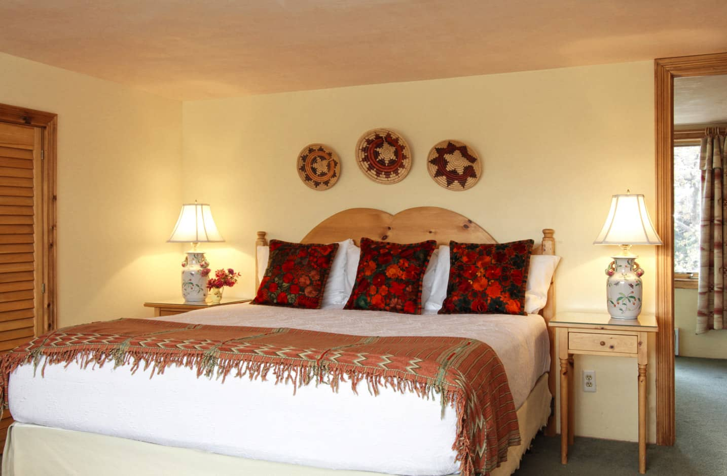 A spacious room with a king size bed