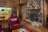 Living room with large wood burning fireplace