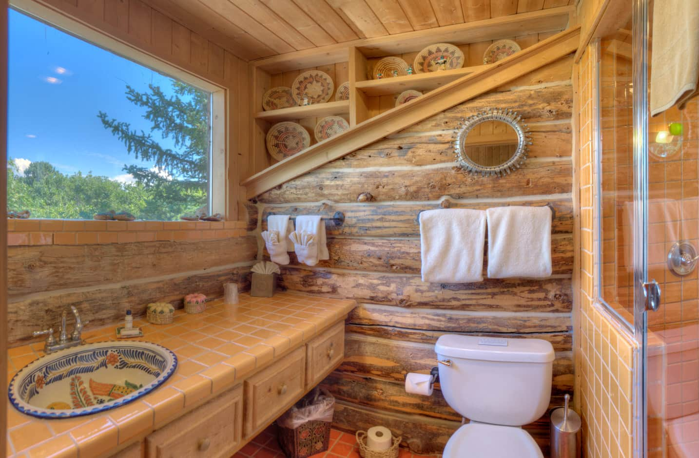 Bathroom with sink and large window