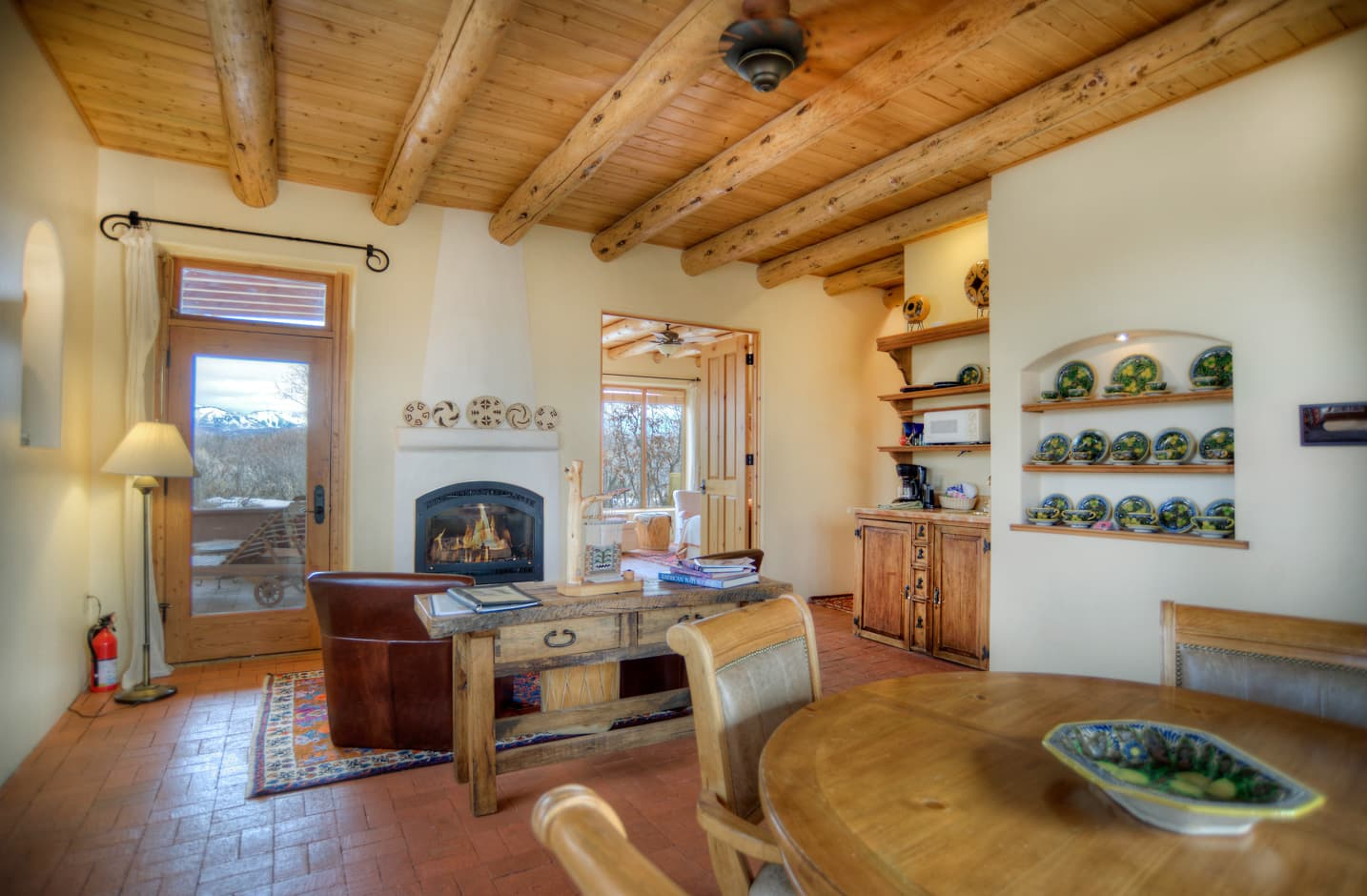 Fireplace and dining table in the Cedar Casita