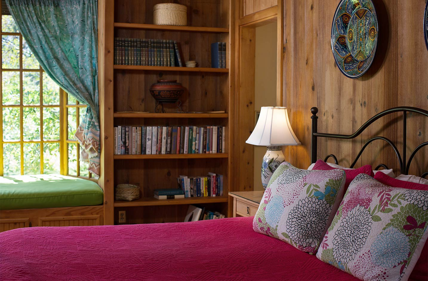 King bed with table lamp and bookshelf