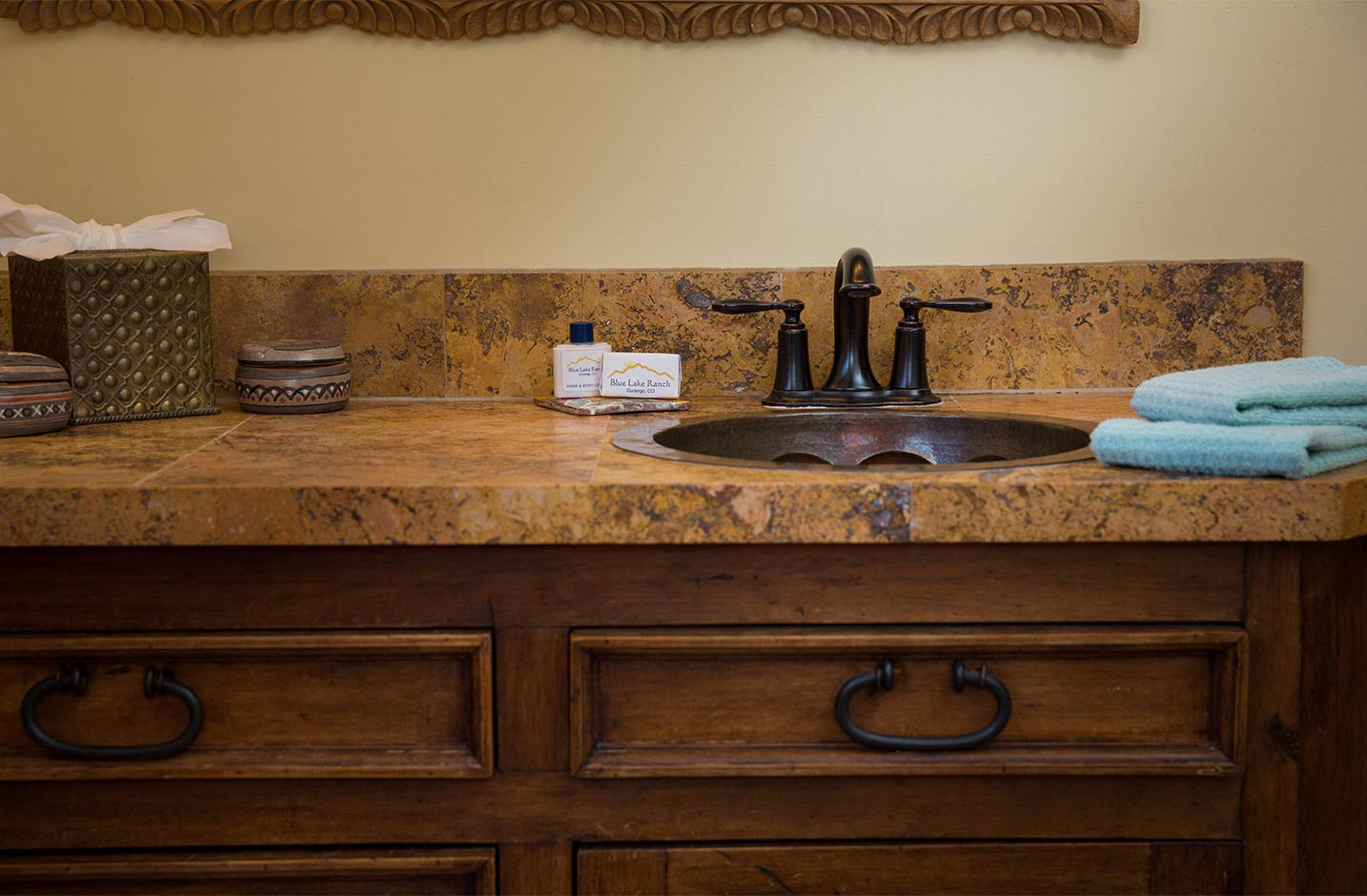 Bathroom counter with sink and hand soap