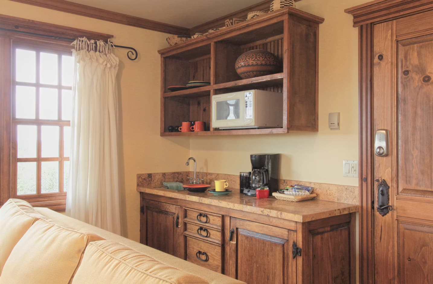 Wetbar with a sink and coffee maker and microwave