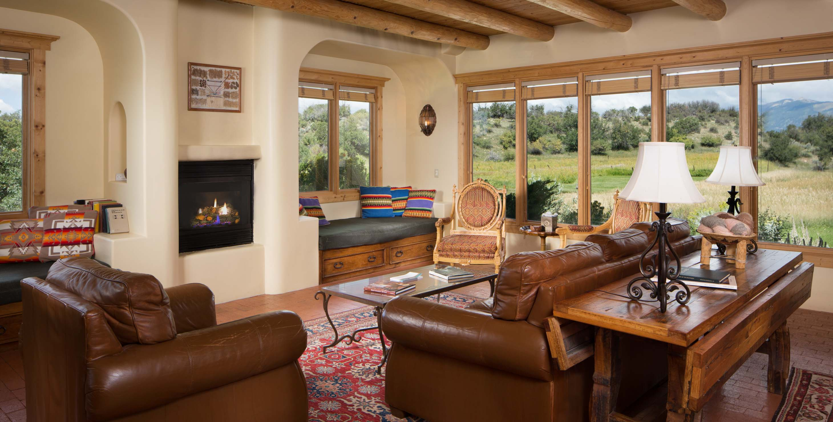 Large living room with fireplace couches and mountain views