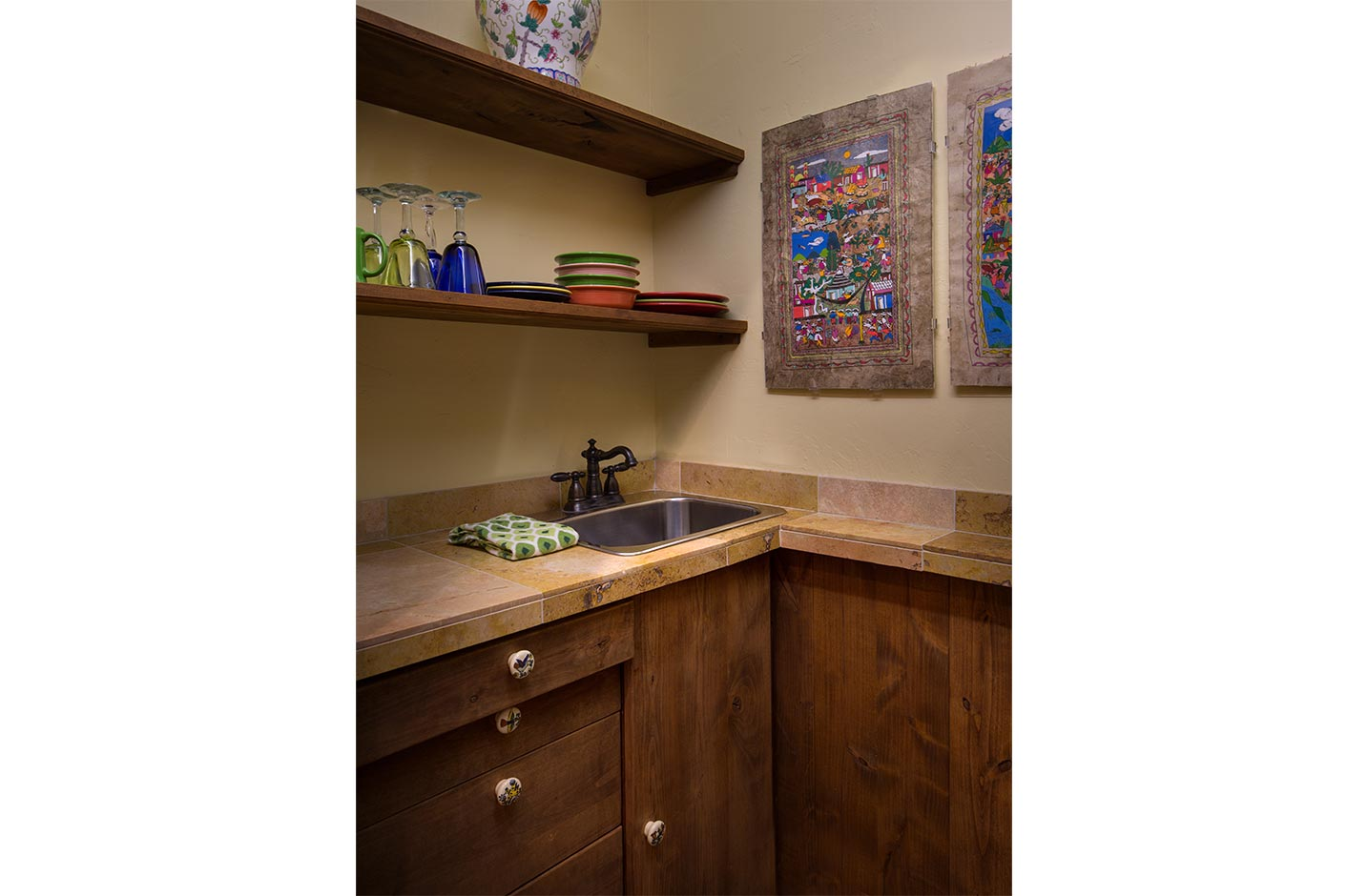 A kitchenette with shelves and dishes