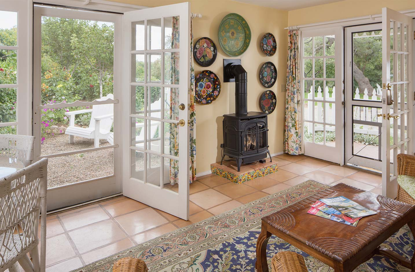 Cozy living room with fireplace and screen door to outside seating