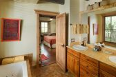 Bathroom with double vanity sinks and Whirlpool tub