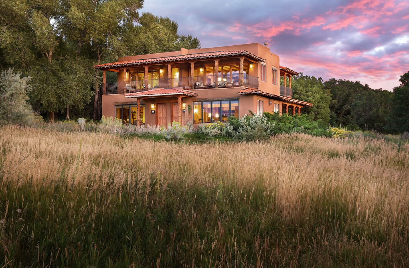 Spring House exterior at sunset