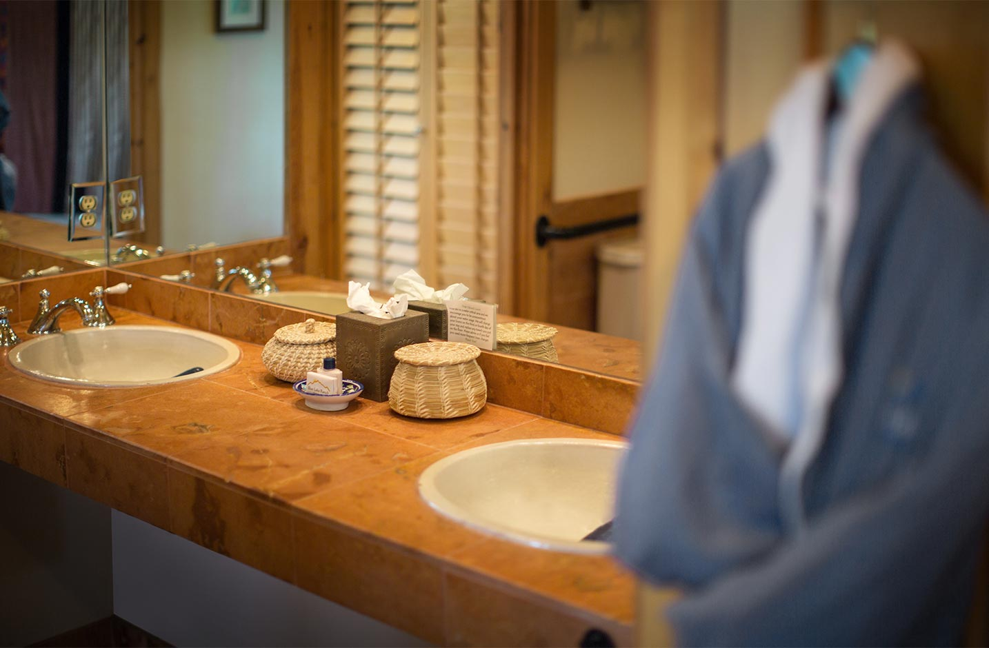 A bathroom with vanity sinks and mirror