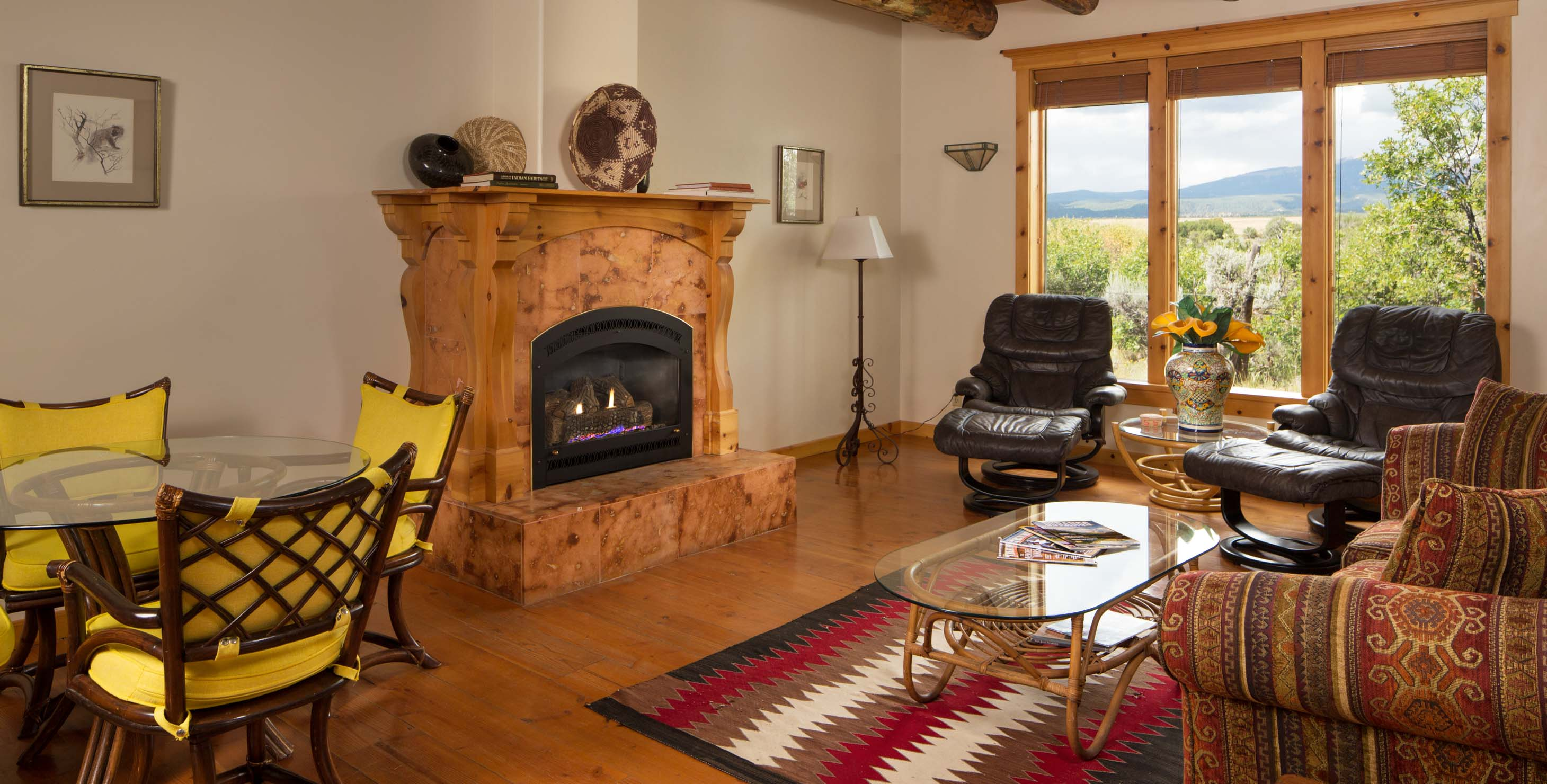 A large living room with fireplace couches and bay windows