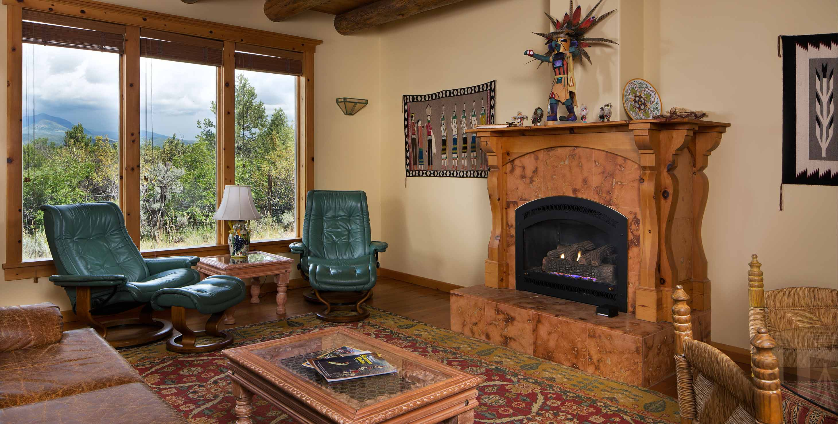 Spacious well lit living room with fireplace and ample seating