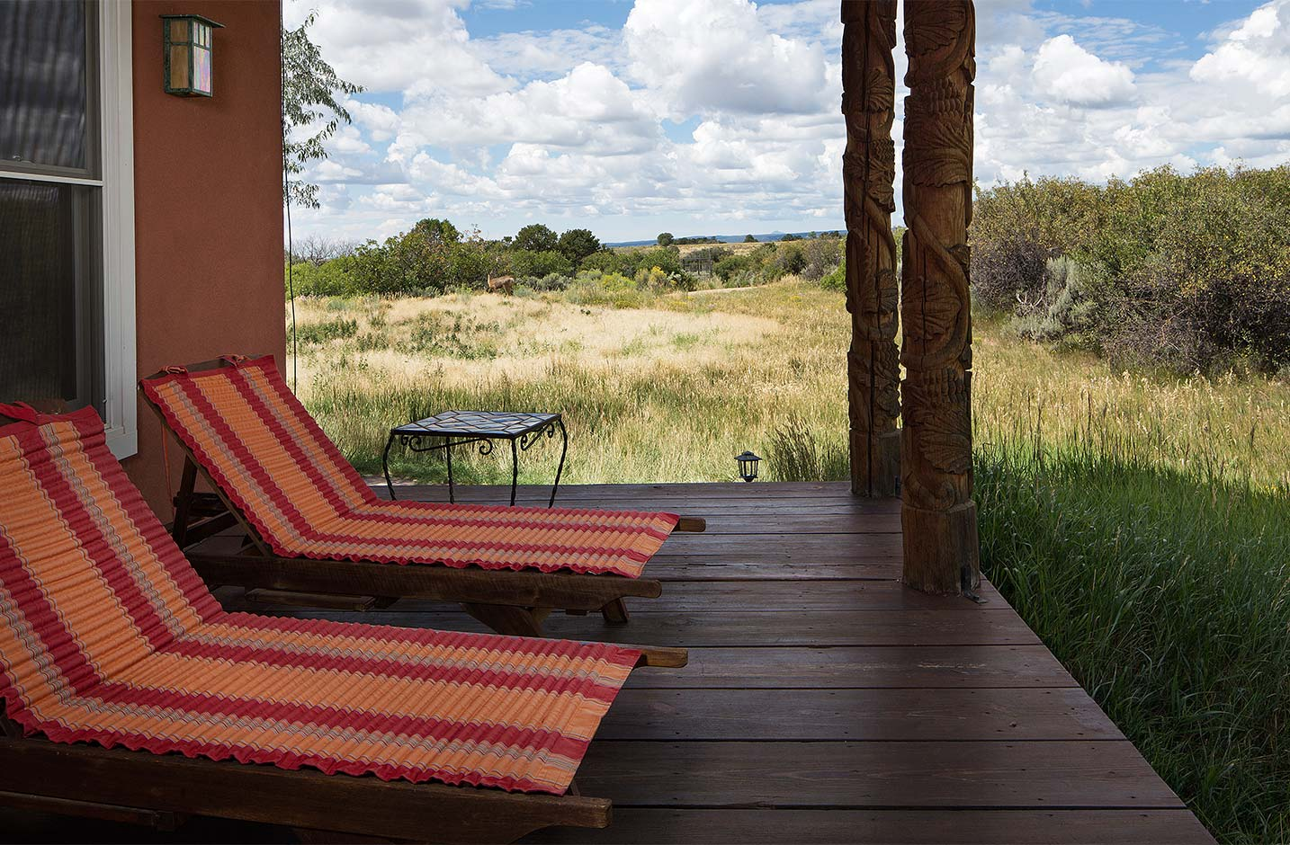 Wooden patio with two reclined chairs