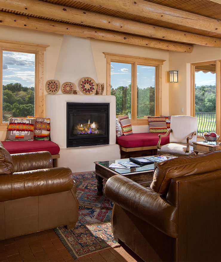 Large living room with gas fireplace and leather sofas panoramic views through large windows