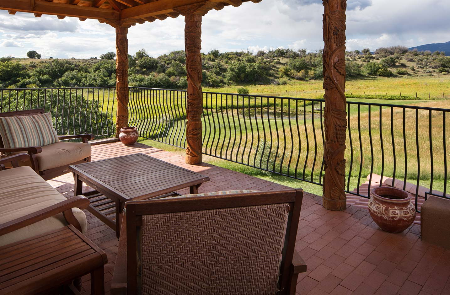 Second floor outdoor patio with ample seating and sweeping views