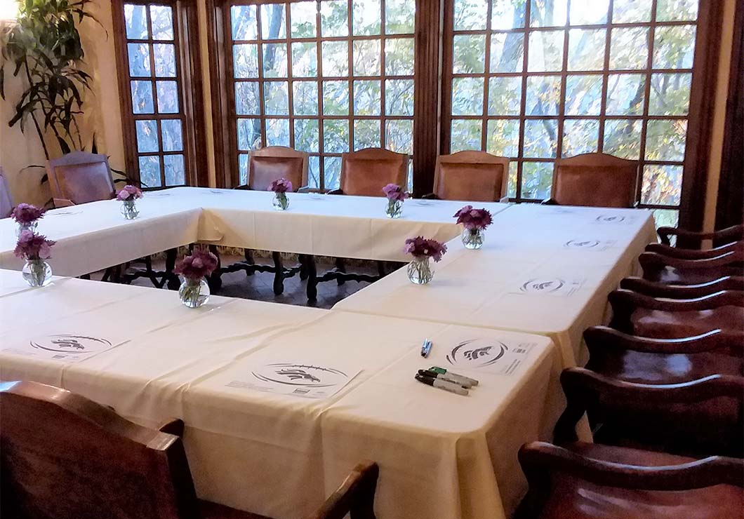 A large room set up for a board meeting