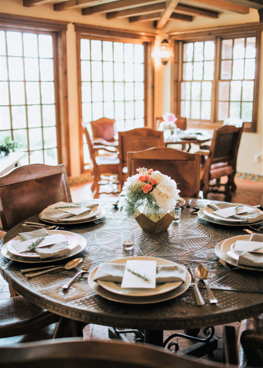 Round dinner table with place settings