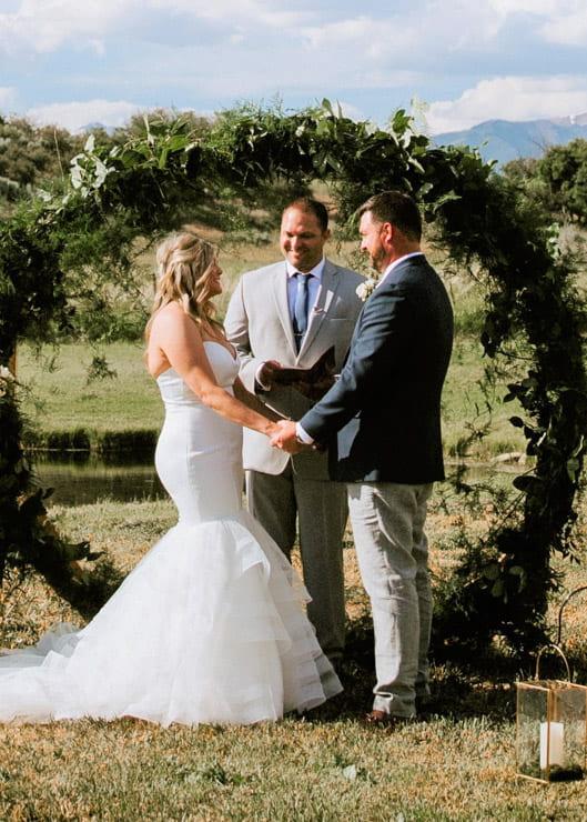 Wedding ceremony outside on an open field under blue sky