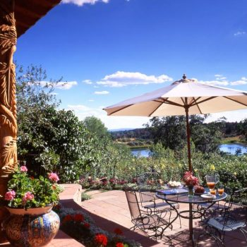 patio and deck overlooking lake
