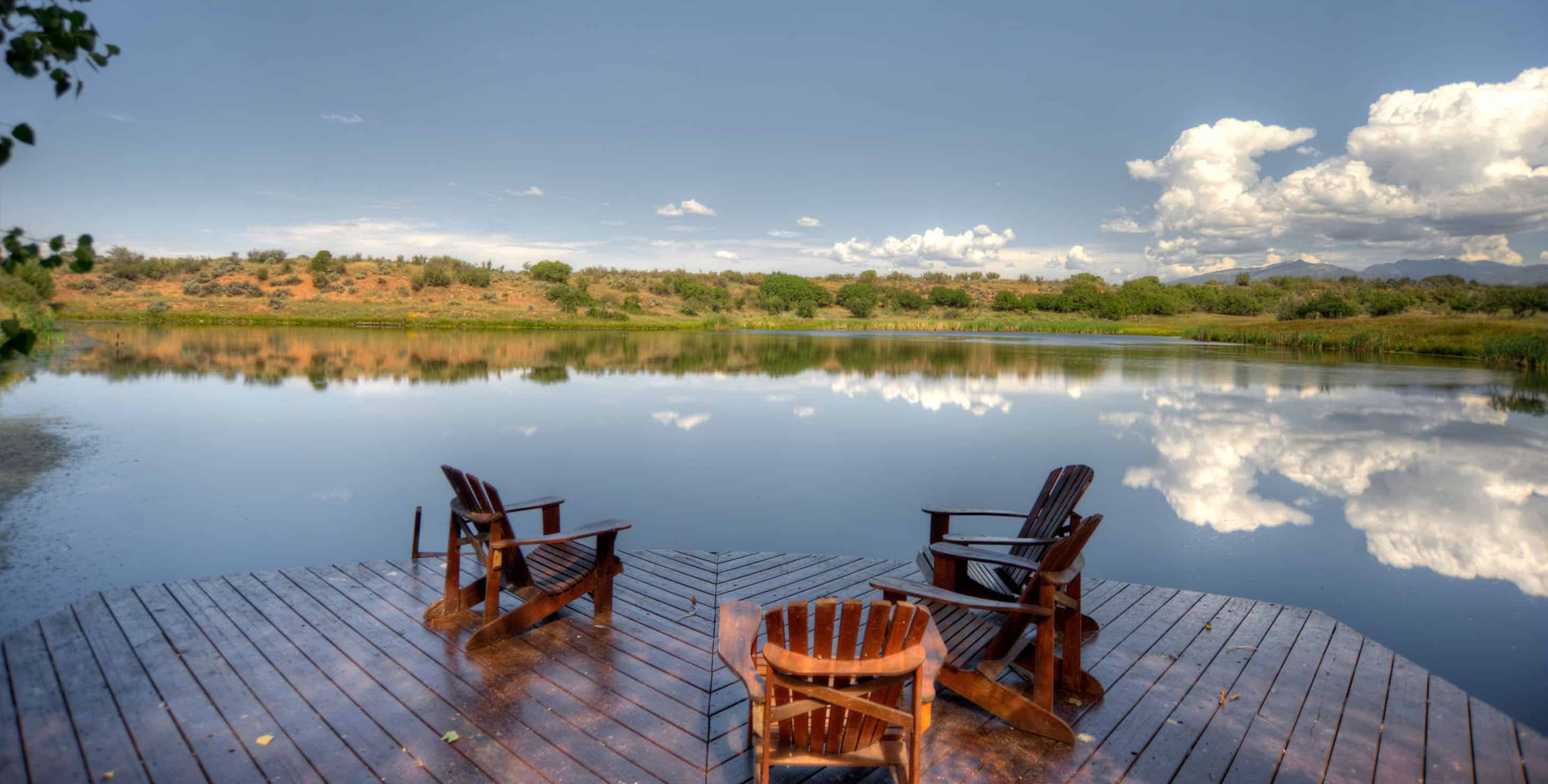 Large deck on the lake with 3 chairs
