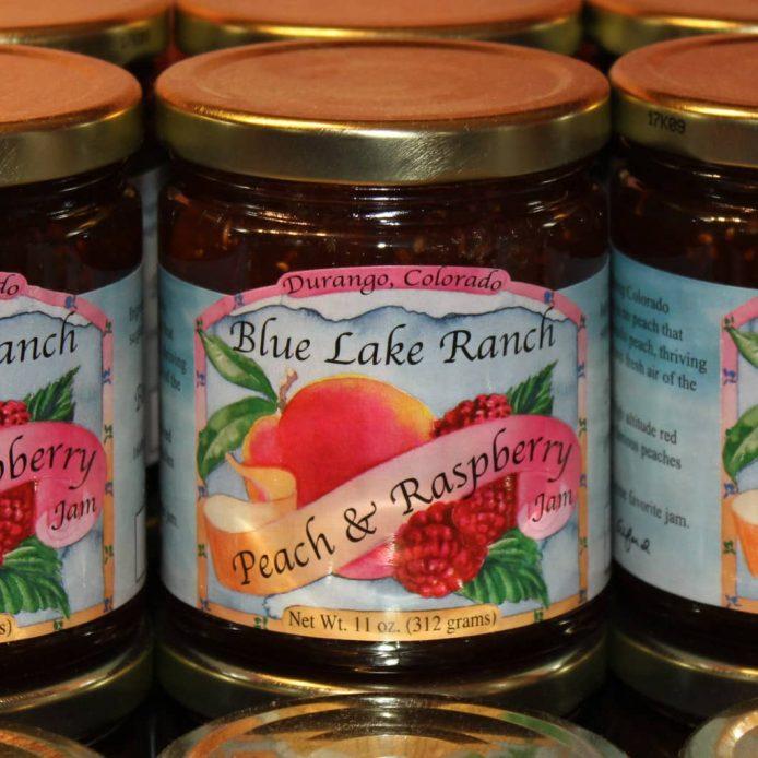 A jar of Blue Lake Ranch Peach & Raspberry Jam