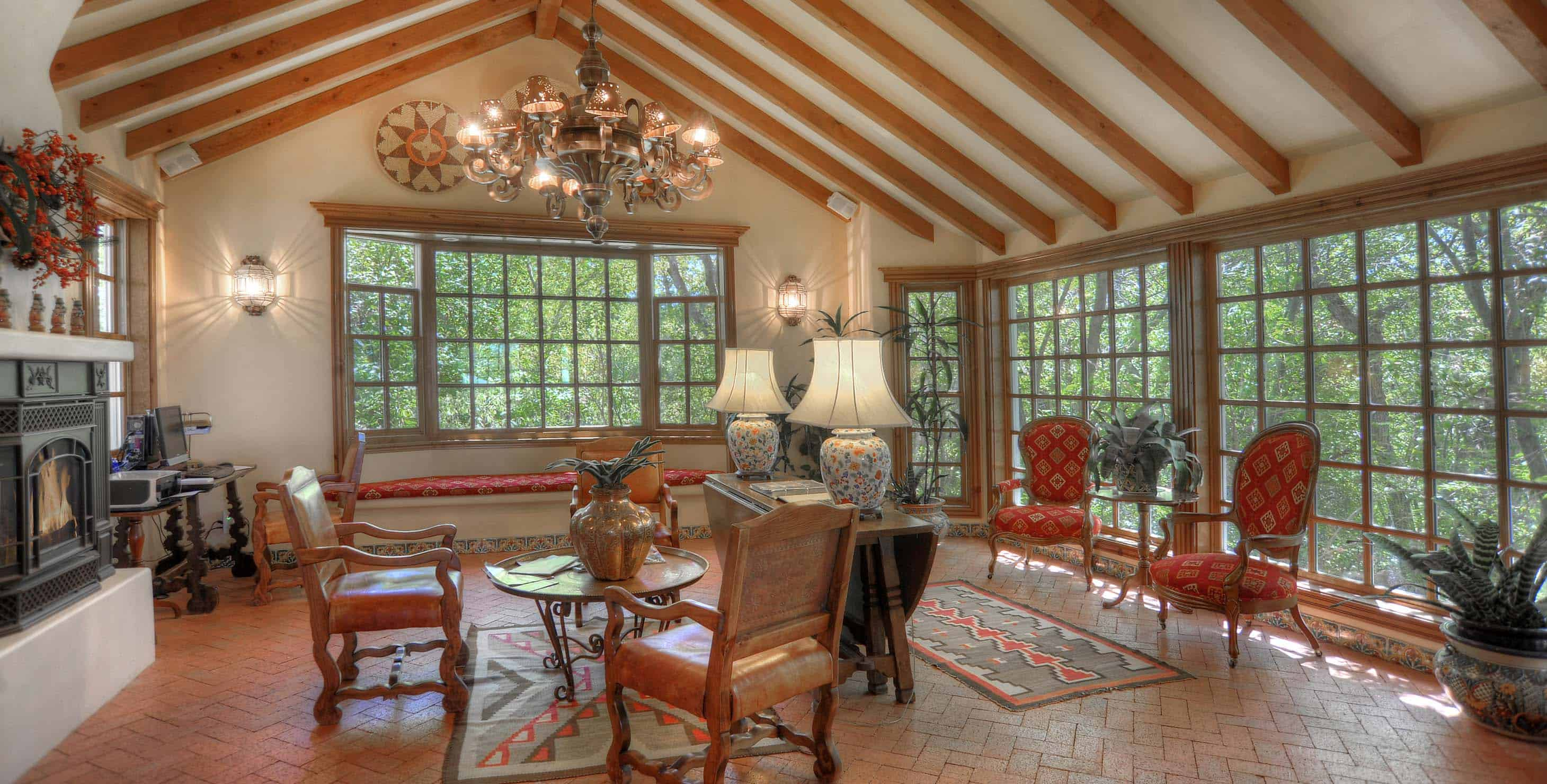 Large sitting area with bay windows, and a gas fireplace