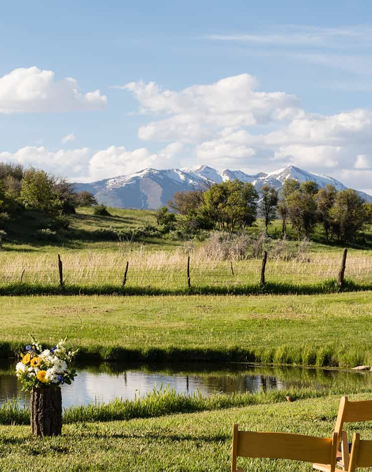 Blue Lake Ranch wedding event with snow capped mountains in the background