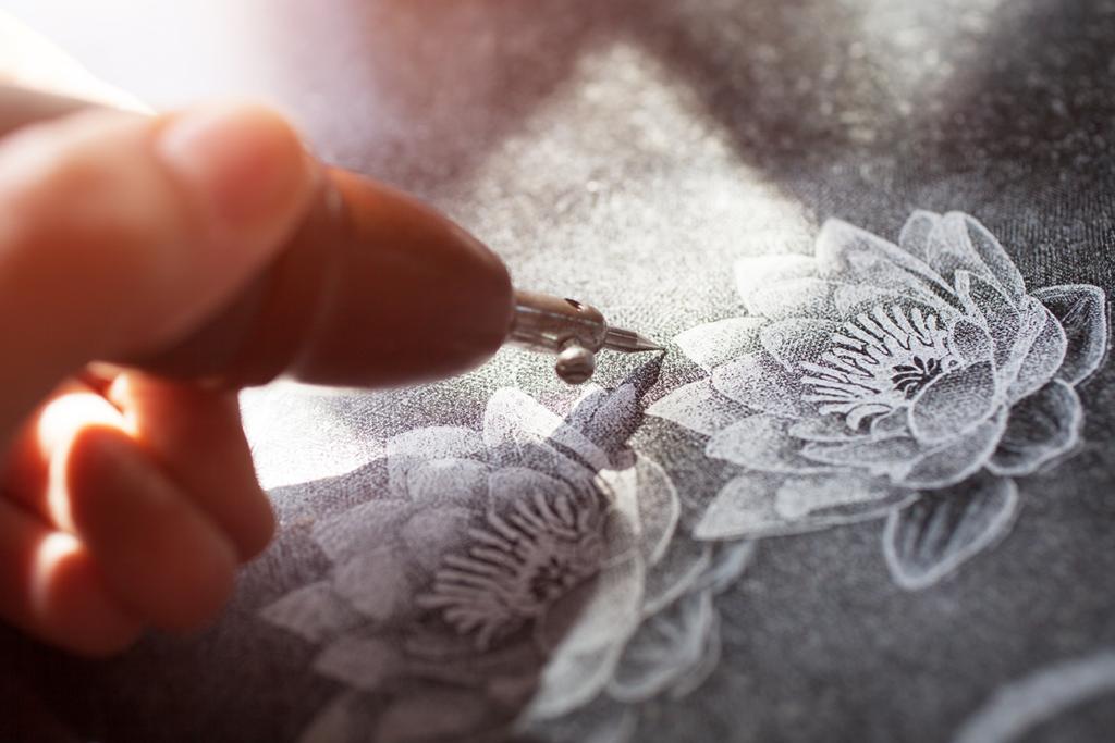 Etching detailed flower artwork onto granite