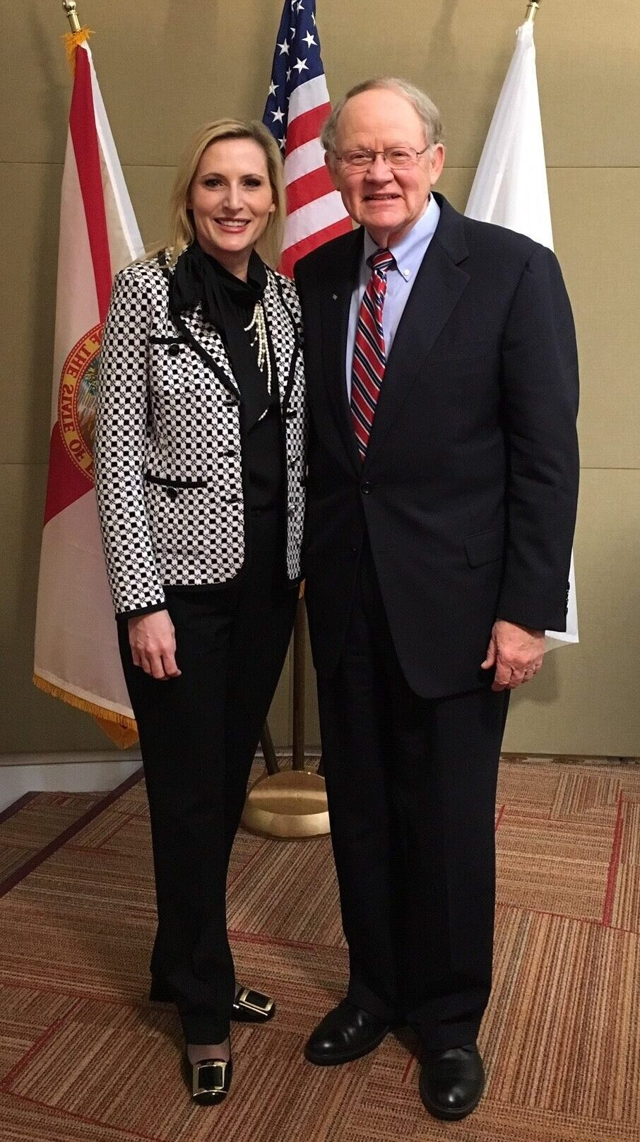 Cyber Florida Executive Director Mike McConnell standing with Florida Secretary of State Laurel Lee