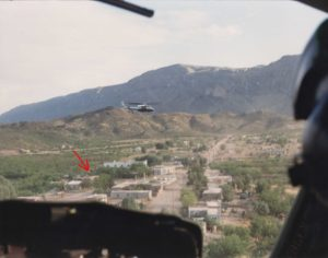 View of Santa Elena from the cockpit of one of the Mexican federal police helicopters. The police helicopters were escorted through U.S. territory by an FBI helicopter, allowing them to attack Acosta by surprise. Acosta holed up in an adobe house marked by a red arrow.