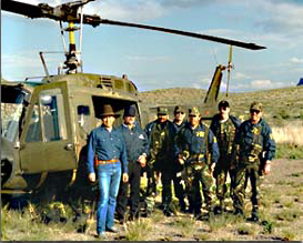 FBI agent Mat Perez (far left) led the American contingent of the assault team that raided Pablo Acosta's final hideout. Here he poses with other FBI agent in front of the U.S. Army helicopter that was used in the operation.