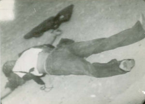 Acosta's body after it was dragged from the house the Mexican police had set on fire.