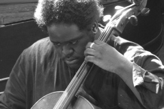 Stamos, cello, performing Schumann Piano Quartet