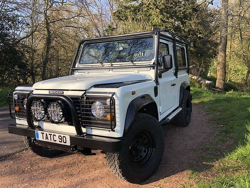 Landrover Defender 90 LHD Hard Top with Roll Cage in Arctic White 1 a