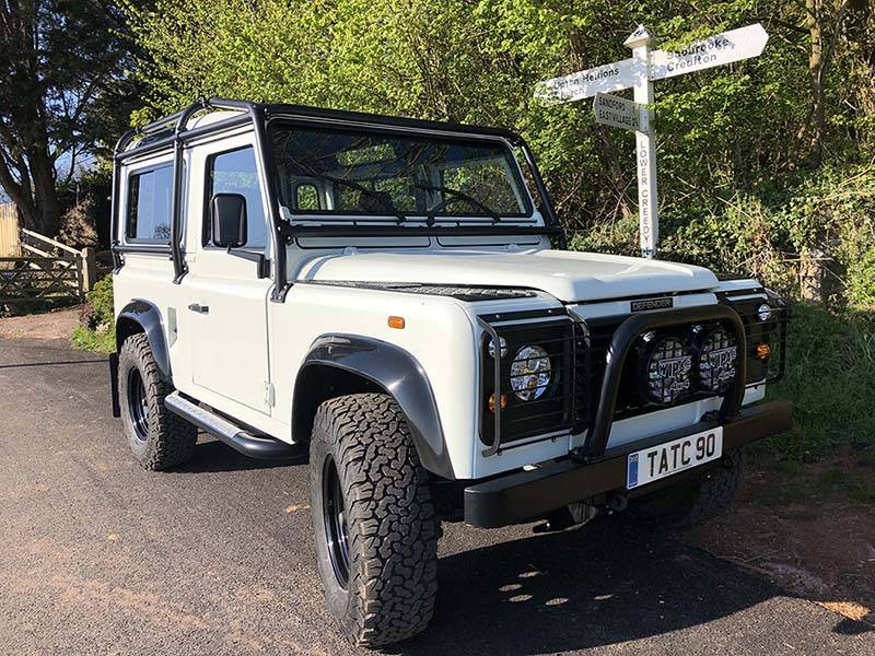 Landrover Defender 90 LHD Hard Top with Roll Cage in Arctic White 20 a