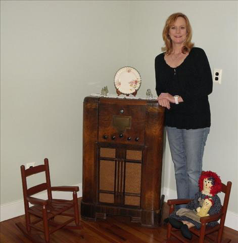 Mary at the radio inside the Hamner home