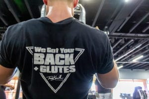 Gym trainer working out in phoenix gym wearing a fitness tshirt