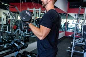 Gym Member Working Out with Dumbbells