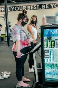 Gym member using body composition machine during free fitness assessment