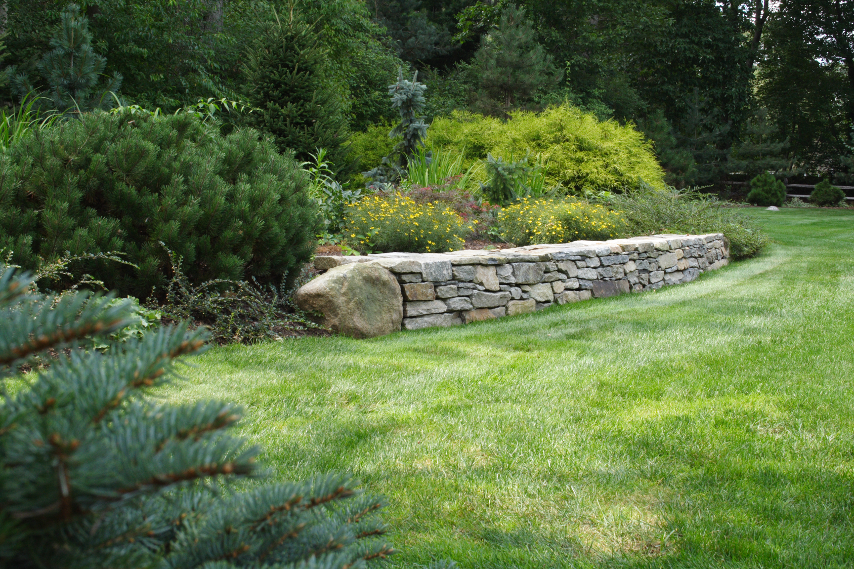 Backyard Walling and Landscaping Done by Burnett's Landscaping
