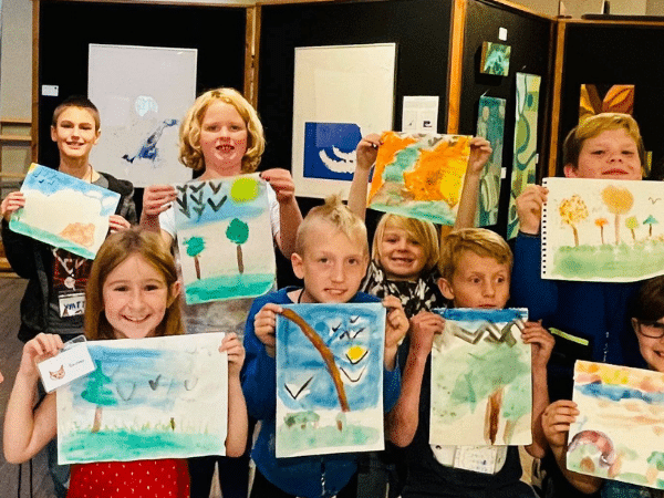 kids holding artwork at the bigfork art and cultural center