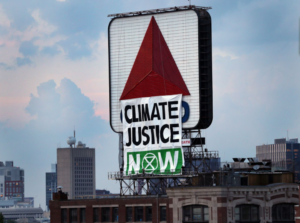 Climate Justice Banner hangs over Citgo Sign