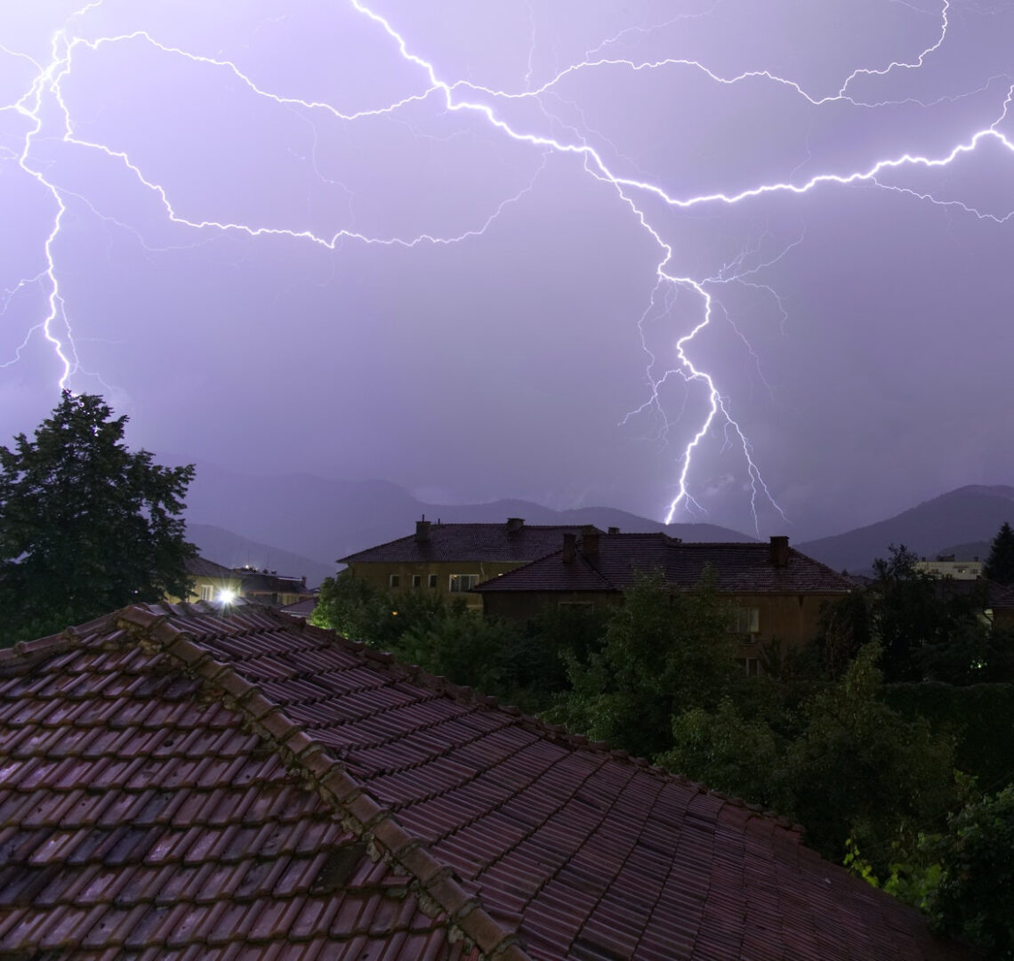 brown roof with lightning at the back
