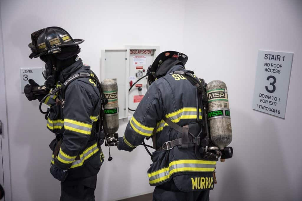 2 Firefighters replenishing their air supply
