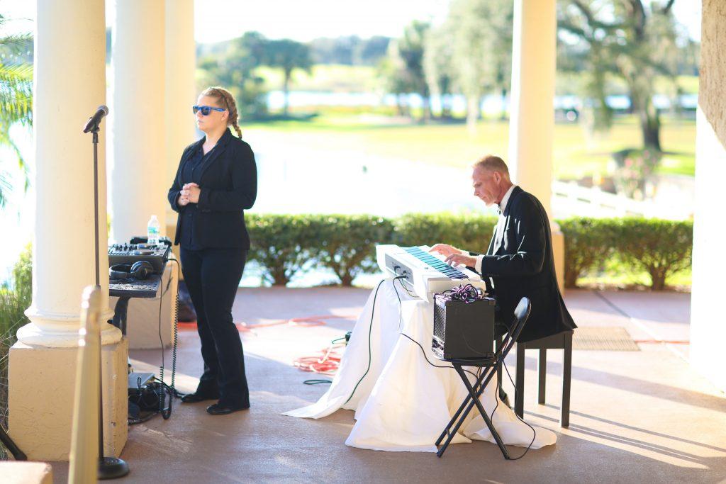 Singer Pianist Spess Neblett Wedding Ceremony   Red & Black Wedding Classic Romantic Dark Mission Inn Resort Anna Christine Events Wings of Glory Photography