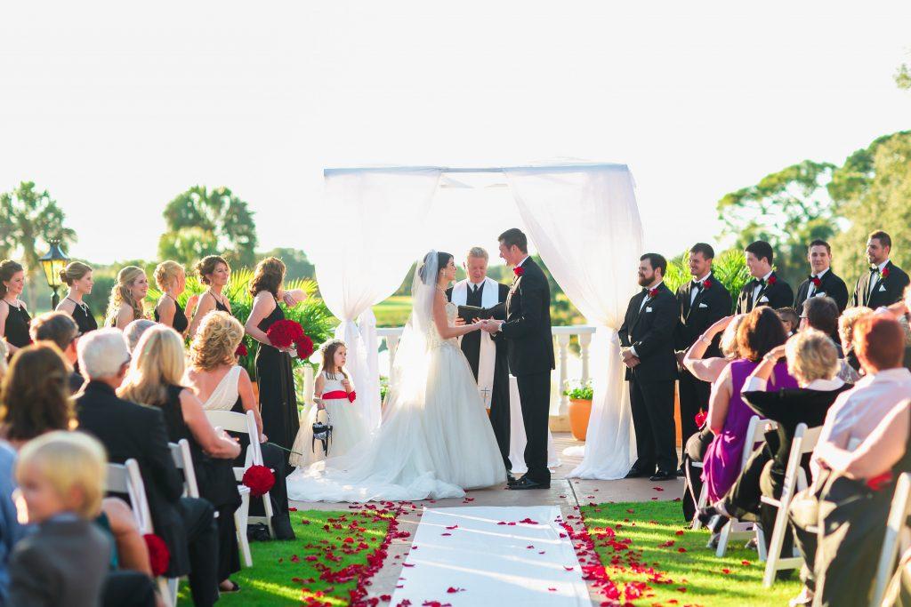 Wedding Ceremony Arbor White Fabric   Red & Black Wedding Classic Romantic Dark Mission Inn Resort Anna Christine Events Wings of Glory Photography