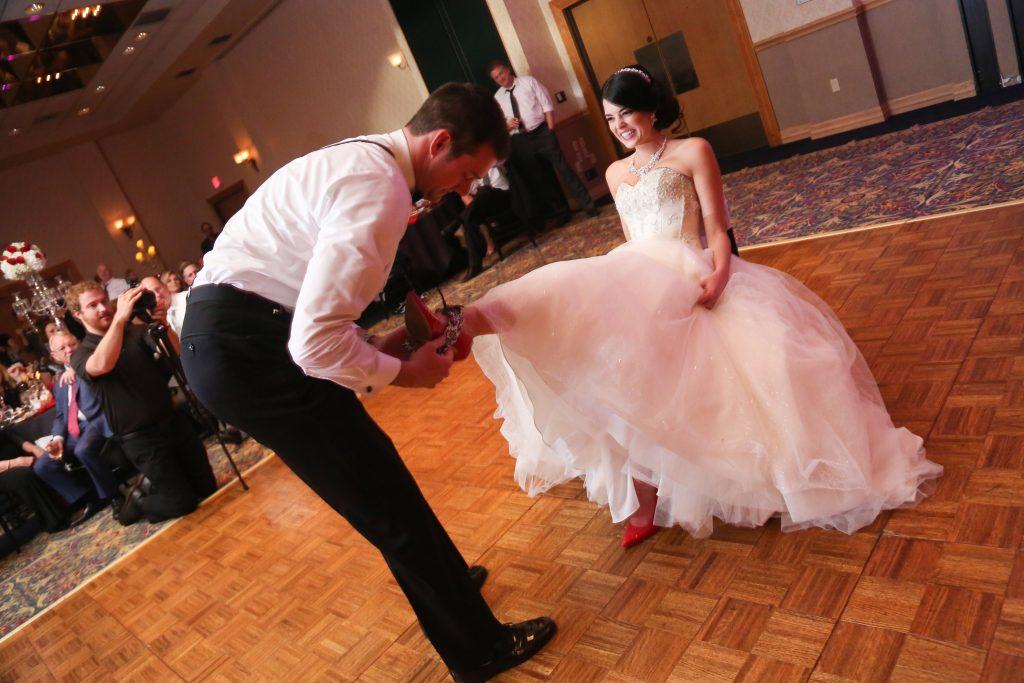 Retrieving the Garter Reception   Red & Black Wedding Classic Romantic Dark Mission Inn Resort Anna Christine Events Wings of Glory Photography