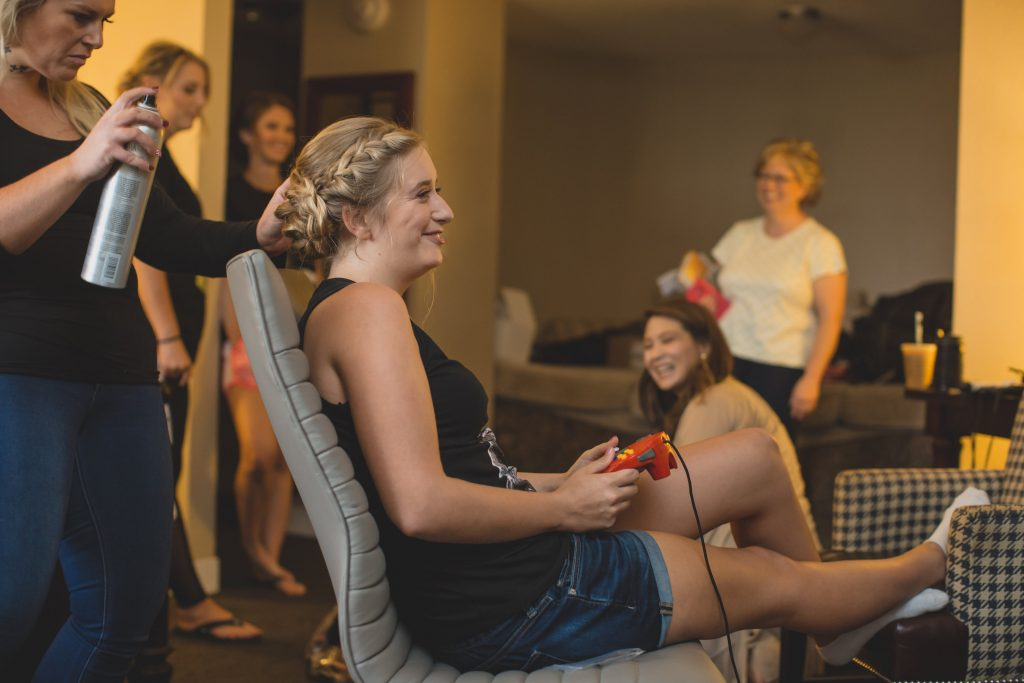 Bride getting ready playing video games | Nerd Geek Chic Wedding Theme Game of Thrones Harry Potter Super Mario Orlando Science Center Anna Christine Events Orlando Wedding Planner Ashley Jane Photography